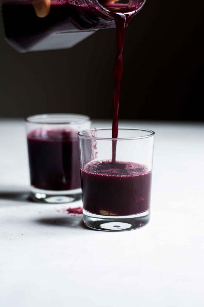 grape juice being poured into glass