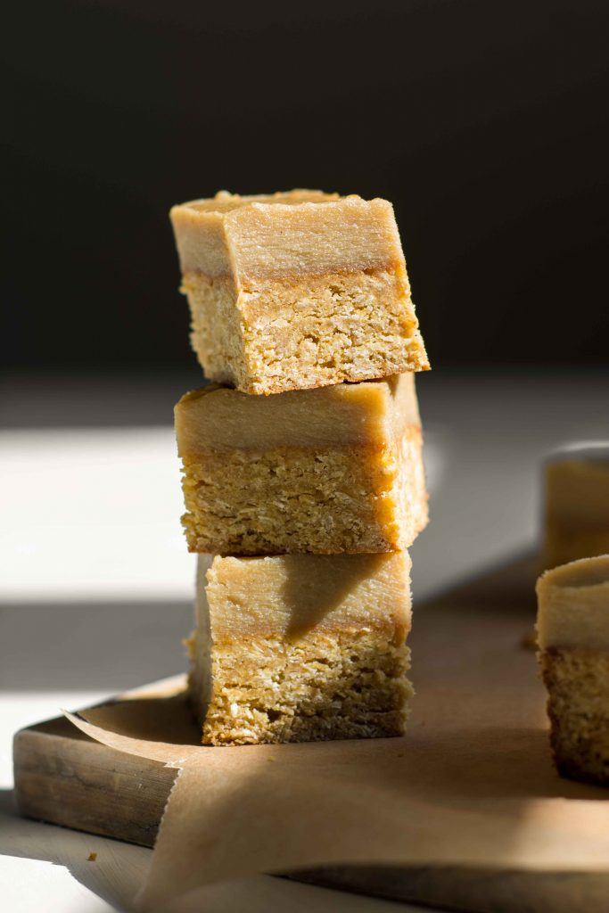 ginger crunch slice bars stacked on top of each other