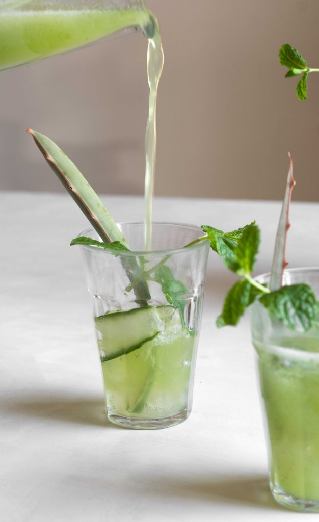 aloe vera cucumber cooler pouring into glass